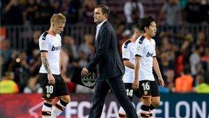 Las caras de los jugadores y Camarasa tras el 5-2 en el Camp Nou eran un poema