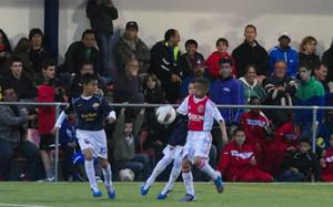 Una imagen de un partido entre el Futbol Academy y el Ajax en el MIC13