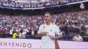 Hazard se presenta a su nueva afición besando el escudo
