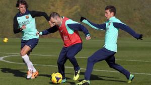 Babunski, con Puyol e Iniesta en un entrenamiento cuando estaba en el Barça B