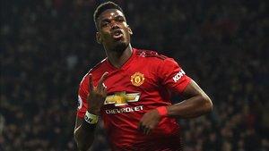 Pogba celebra un tanto con el United