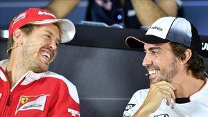 Vettel y Alonso, durante sus etapas en Ferrari y McLaren